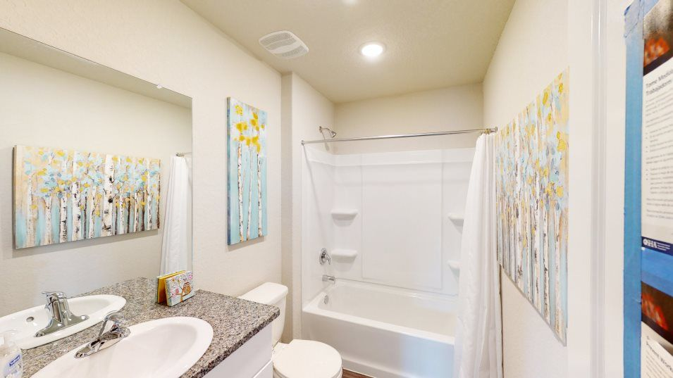Braun Landing Rundle Bathroom 2:Two bedrooms share a hall bathroom with a bathtub, shower and sink.