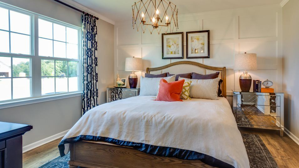 Fendol-Farms Residences II Collection Catalina II:Sweet dreams fill the owner's suite. It has a bedroom with a tray ceiling, a walk-in closet and a sp