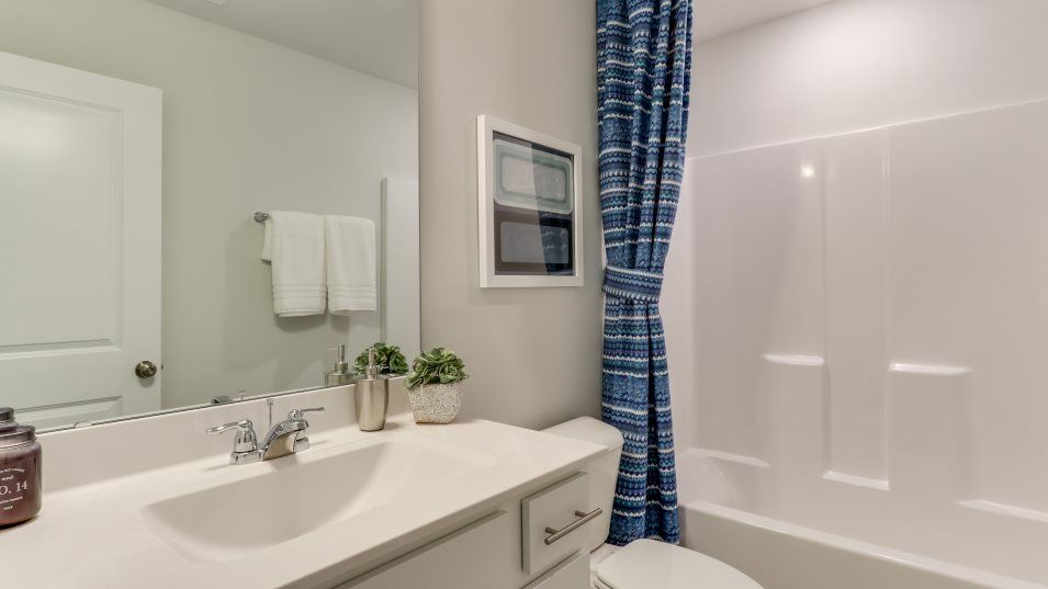 Magnolia Trace Mitchell Bathroom 3:This downstairs bathroom is privately located inside the bedroom, perfect for guests.