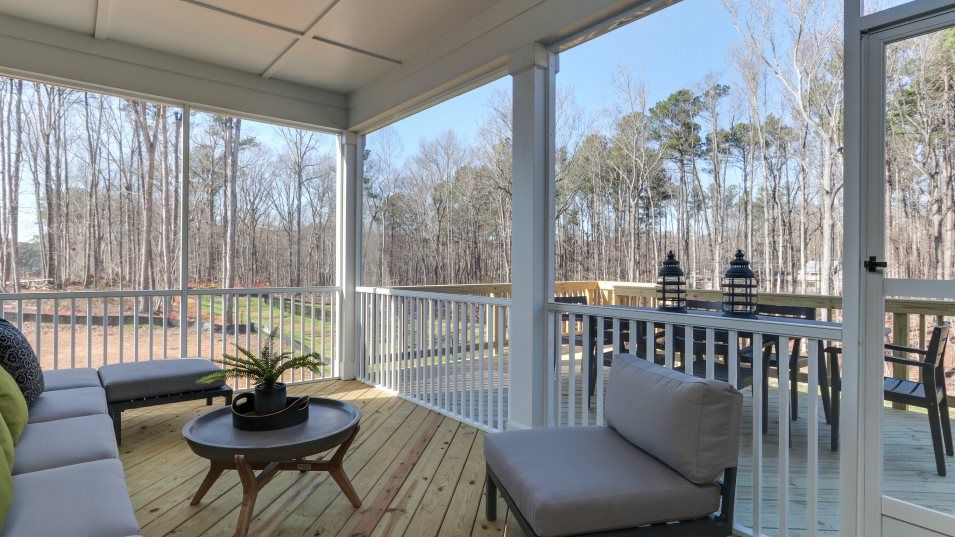 Legacy at Jordan Lake Galvani II Outdoor Space:Accessible off the nook and kitchen is a large screened porch for outdoor space in the back of the h