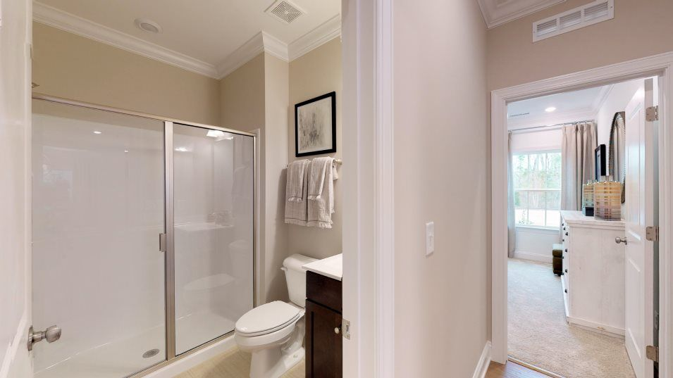 Clifford Glen Mayflower III Bathroom 3:A full bathroom on the first floor comes well-equipped with a high-end vanity and a shower with a gl