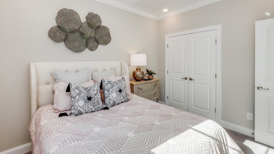 Auburn Village Garnet Collection Dover II Bedroom:Situated near each other, the secondary bedrooms o er privacy to homeowners and their guests.