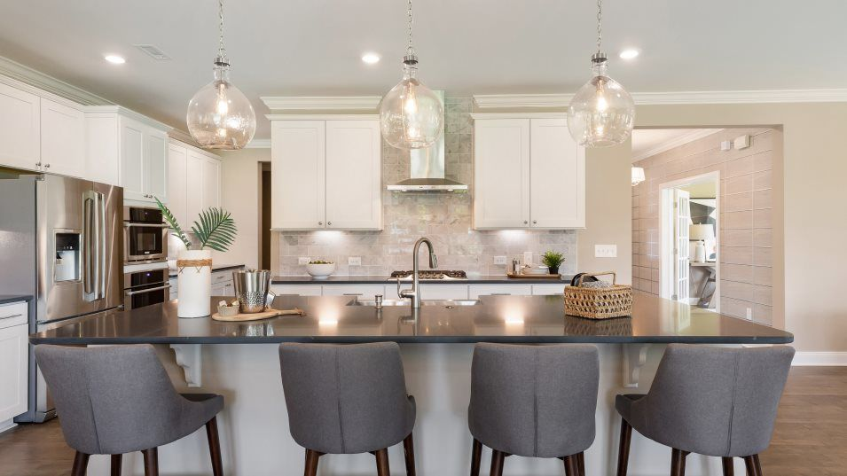 Auburn Village Diamond Collection Porter Kitchen:Cooking is fun in the gleaming kitchen, which has stainless-steel appliances, a walk-in pantry and a