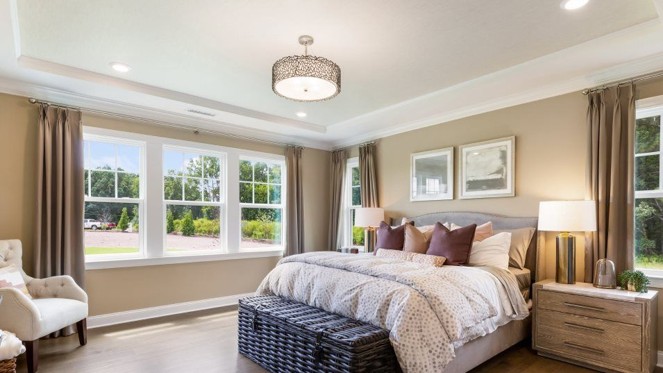 Auburn Village Diamond Collection Porter Owner's S:The tranquil owner's suite prioritizes comfort with stylish plank flooring and serene sunlight from