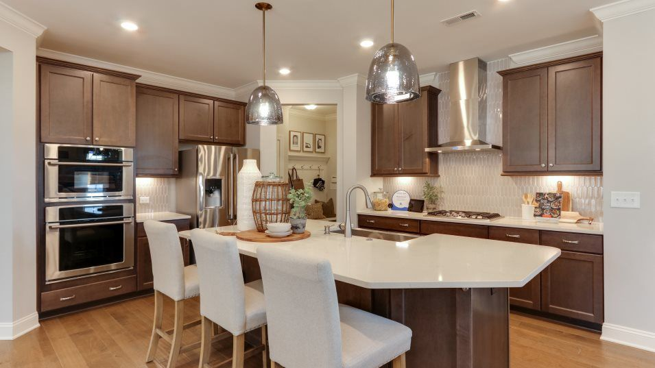 Geneva Classic Collection Galvani II Kitchen:The chef-caliber kitchen has birch cabinetry, granite countertops and stainless-steel appliances. A
