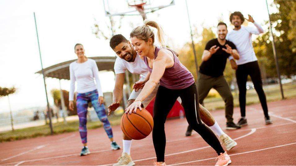 A group playing basketball