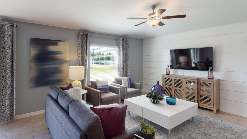 Riverstone The Estates Dover Family Room:The natural gathering space of the home, the family room is ready for movie nights, competitive boar