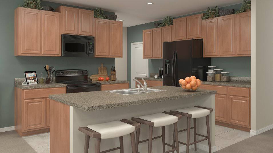 Riverstone The Estates Richmond Kitchen:Designed for convenience, the designer kitchen features a center island that doubles as a breakfast