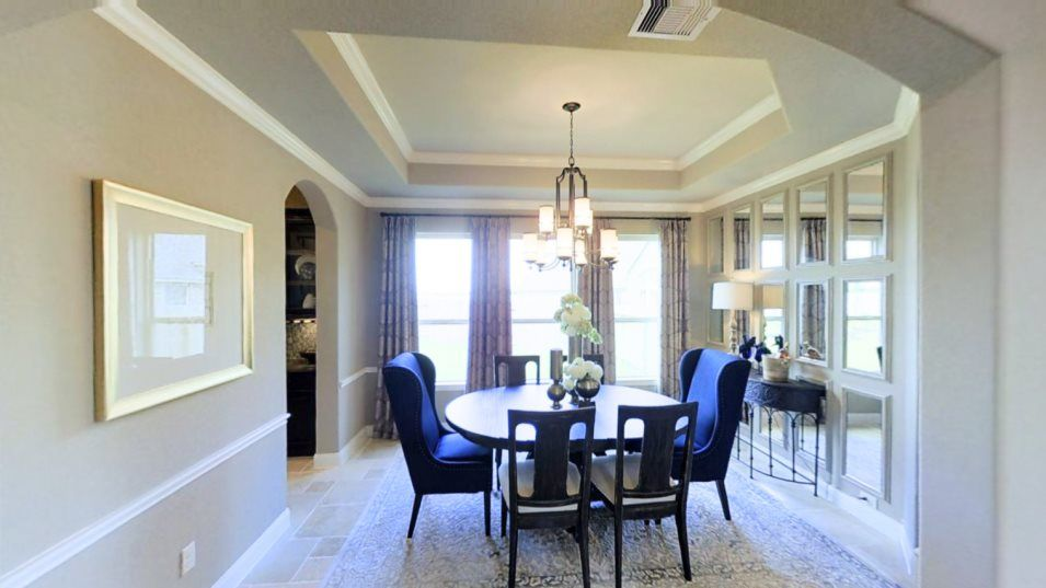 Woodtrace Wentworth Collection Whitaker Dining Roo:Set apart for added privacy, the formal dining room is perfect for meals or celebrations that call f