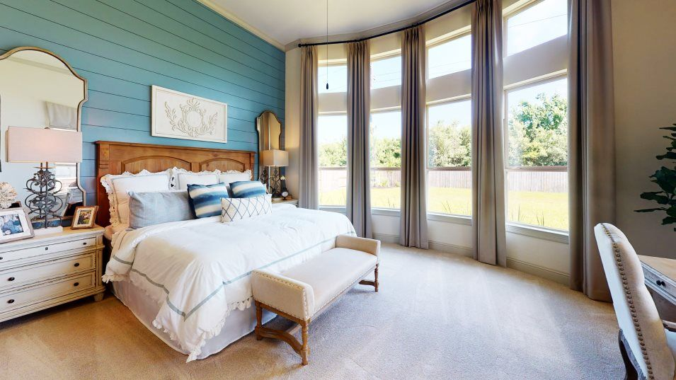 Vistas at Klein Lake Classic Collection Chopin Own:The owner's suite is in the back of the home for added privacy with  floor-to-ceiling bay windows, a