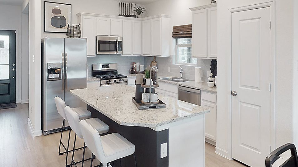 Newport Magnolia Collection Bennett Kitchen:The modern kitchen enjoys gleaming appliances, smooth granite countertops and a multiuse island that