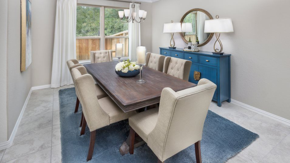 The-Groves Brookstone Collection Alabaster II Dini:The formal dining room gives homeowners space for meals with guests and holiday celebrations.