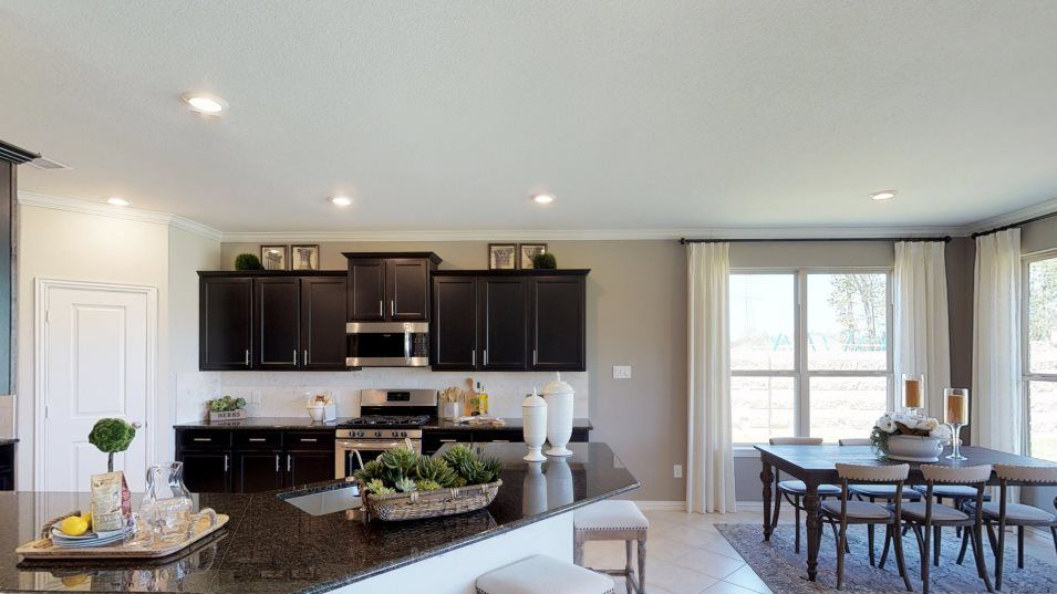 Veranda Brookstone Collection Terrazzo II Kitchen:A peninsula anchors this lovely kitchen, surrounded by chrome appliances, granite countertops and a