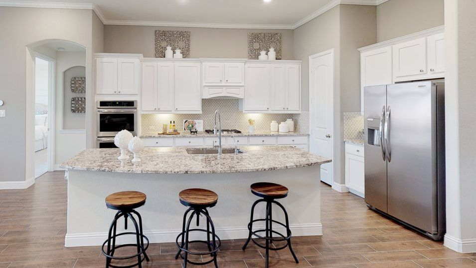Jordan Ranch Vista Collection Amistad Kitchen:Designed with the home chef in mind, this bright kitchen features gleaming granite countertops, stai