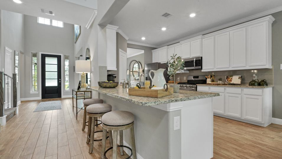 Alexander-Estates Fairway Collection Wakefield Kit:Designed with the home chef in mind, this bright kitchen features gleaming granite countertops, bran