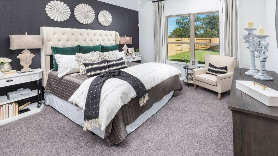 Heritage-Reserve Wildflower Collection Larkspur Ow:This spacious owner's suite features an en-suite bathroom and a large walk-in closet with shelving,