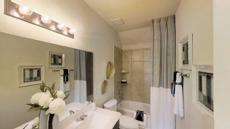Heritage-Reserve Wildflower Collection Larkspur Ba:A dual-sink vanity with drawer and cabinet storage joins a combined bathtub and shower for streamlin