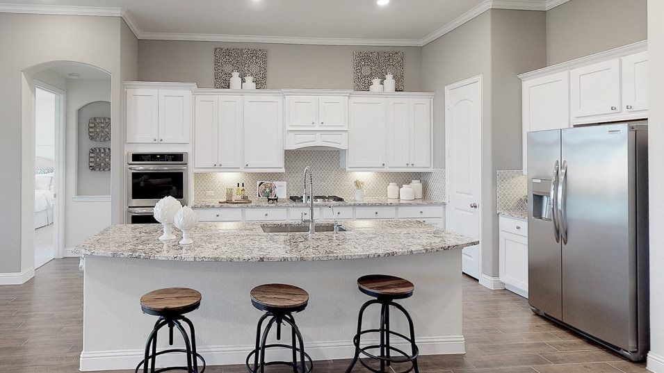 Lakes-Of-Savannah Texas Reserve Collection Amethys:Centered around a large island with bar seating and storage space, this well-equipped kitchen featur
