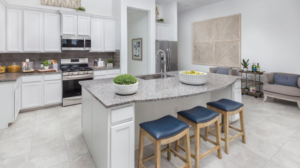 Lakes-Of-Savannah Fairway Collection Cantaron Kitc:As the center of the home, this kitchen highlights a center island with chrome sink fixtures and ove