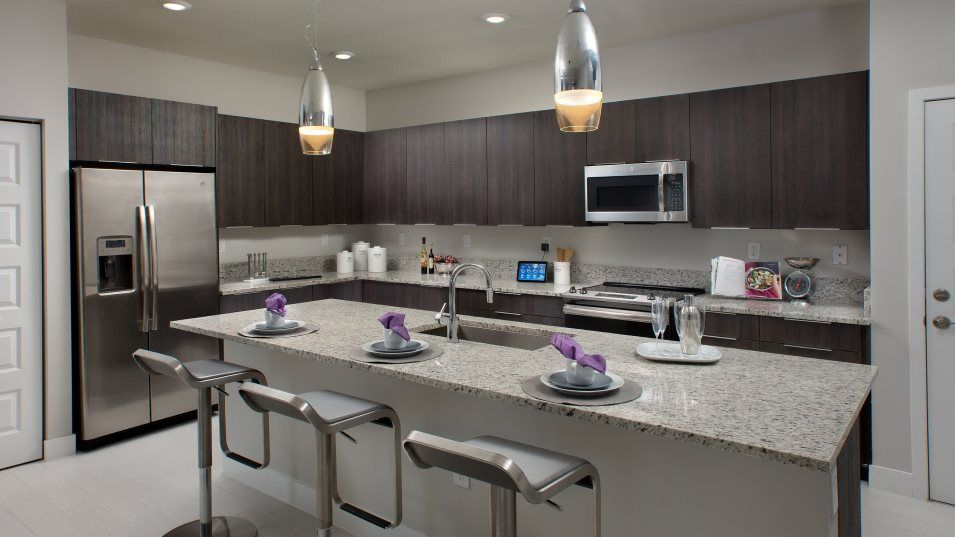 Urbana 2-Story Townhomes MODEL CF SKYVIEW Kitchen:This kitchen was designed with food prep in mind, featuring a generous center island and ample count