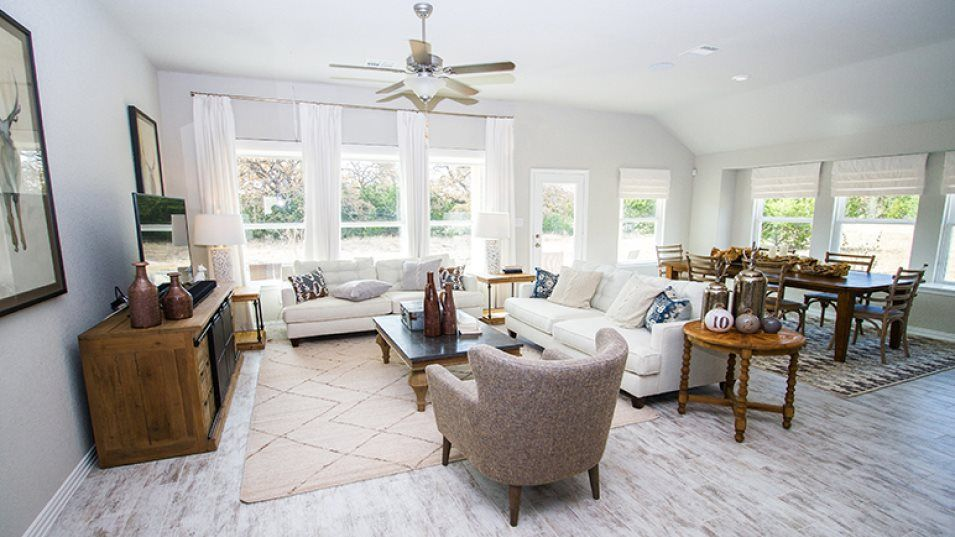 Potranco-Run Brookstone II Sig & Westfield 3-car G:The comfortable family room has ample space for relaxing at the end of the day or hosting game night