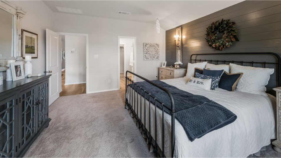Potranco-Run Brookstone II Sig & Westfield 3-car J:The owner's suite is tucked into a back corner of the home for maximum privacy and features a large