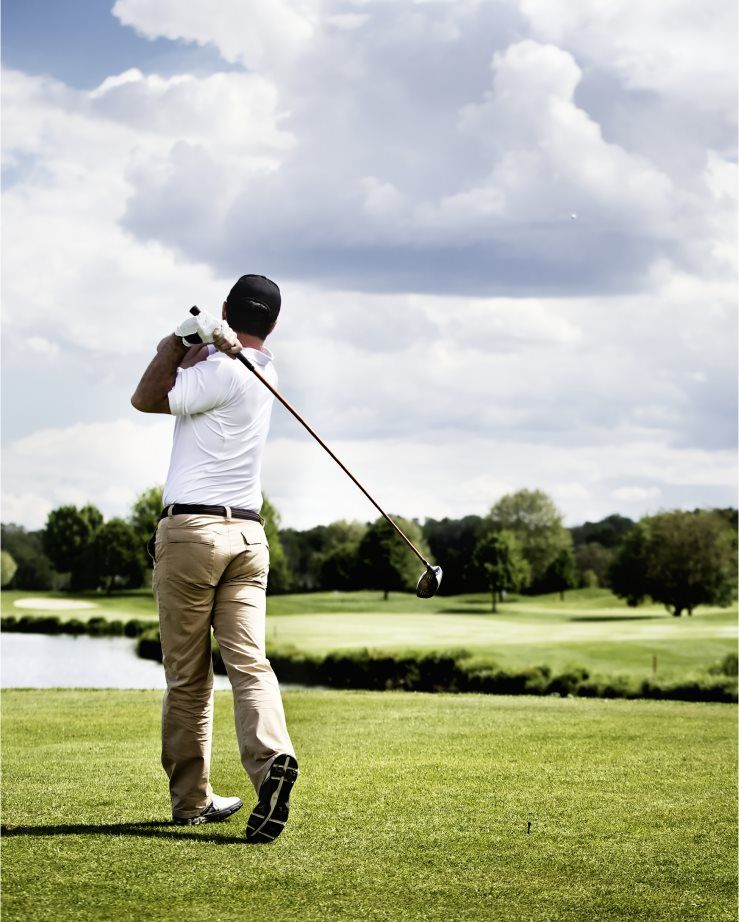 A person golfing
