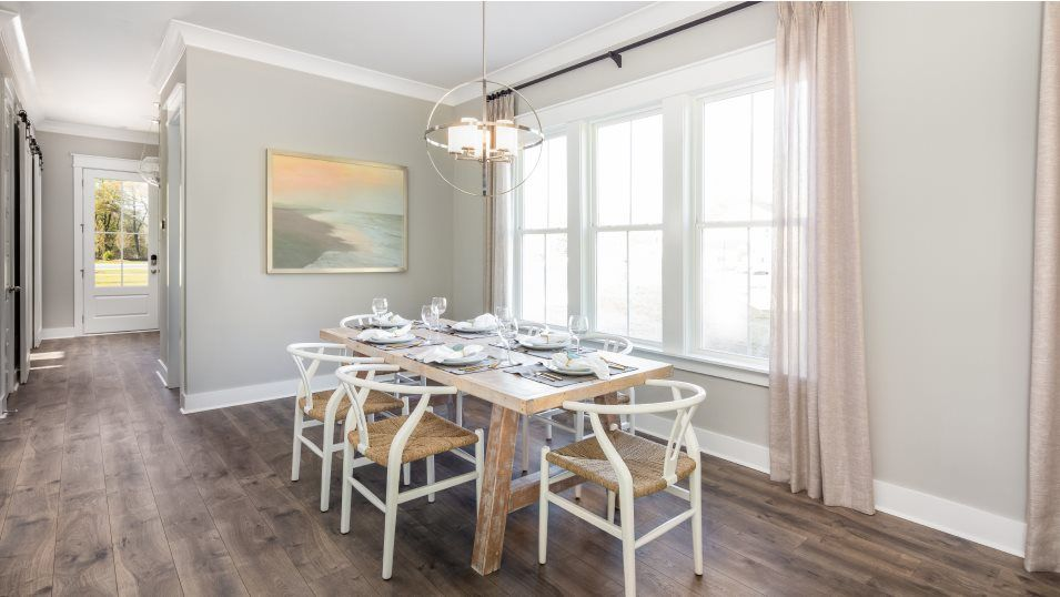 Carolina Park The Village PINCKNEY Dining:Located near the entry, the dining room is set against an elegant wall of windows and provides a spa