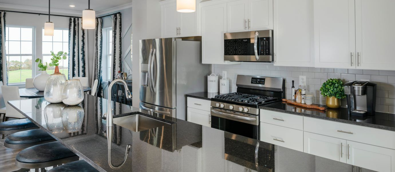 Patapsco Glen Arcadia Rear Garage Kitchen:The spacious kitchen is the star of the home and showcases an oversized center island for casual din