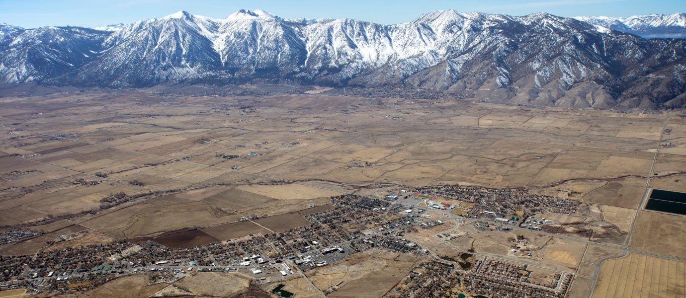 Aerial view of community with mountains in background