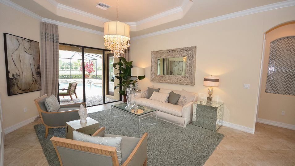 Estate Homes Heritage Landing Toscana Living Room:One of the first rooms visible from the foyer, the formal living room is ideal for hosting guests, w