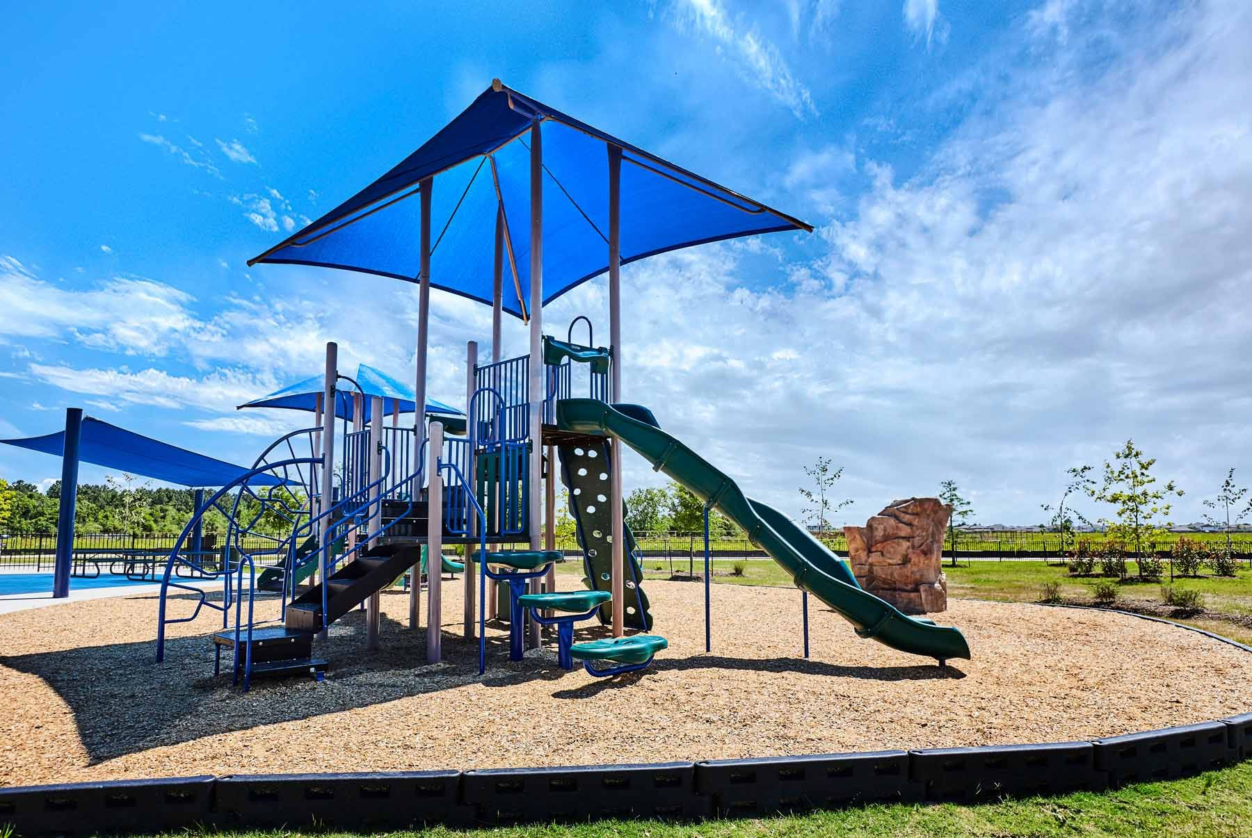LGI Homes at Seacrest:Seacrest hosts a community park with a playground, splash pad and picnic areas!