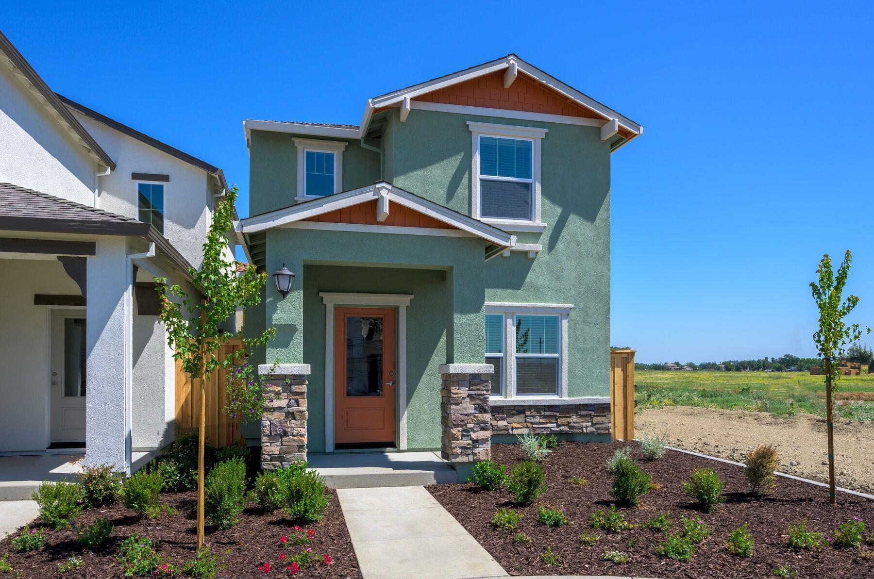 The Crystal:A 3/4 lite door & stone detailing adds to the charm of this home!