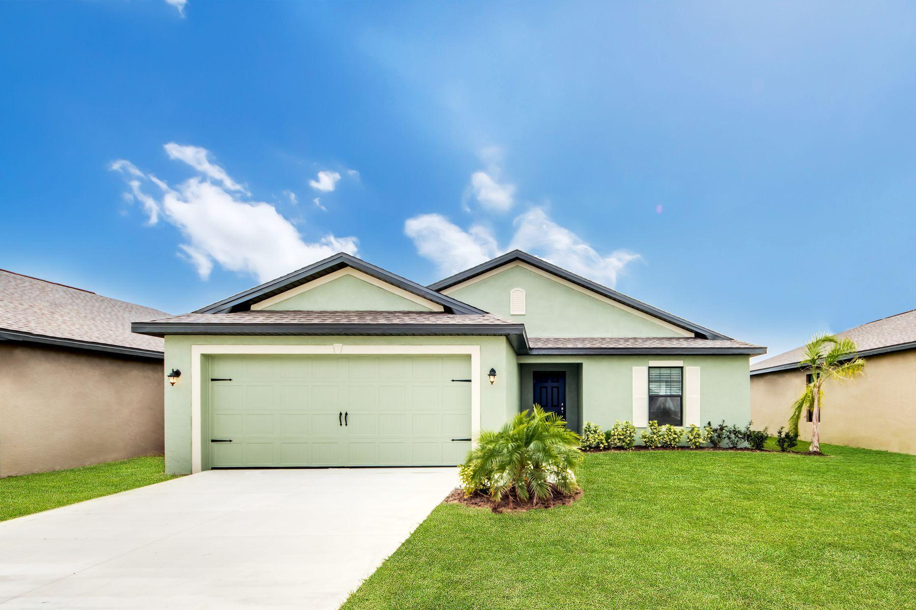 The Bokeelia by LGI Homes:Lush front yard landscaping adds to great curb appeal at the Bokeelia