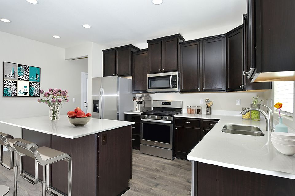 Upgraded kitchens included:5th Plain Creek Station by LGI Homes