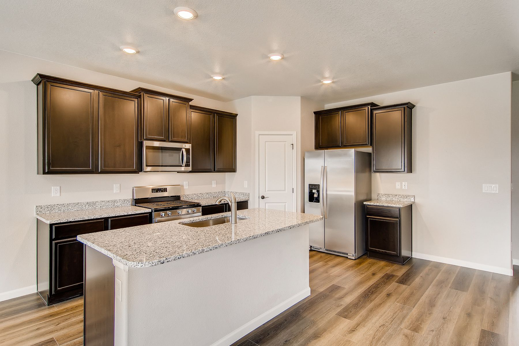 Stainless steel kitchen appliances included:The Pike - LGI Homes