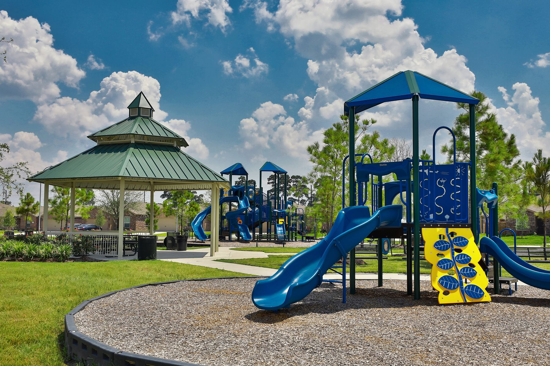 The Reserve at Park Lakes by LGI Homes:Multiple play structures offer challenging fun for children of all ages.