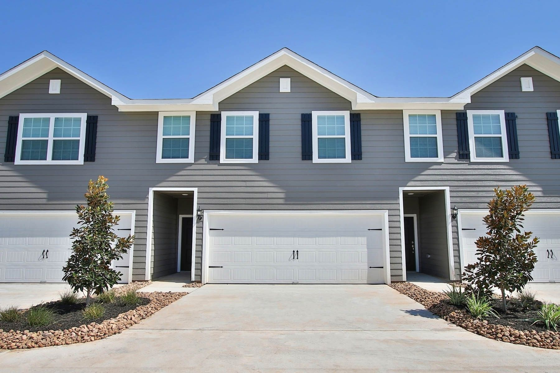 Windsor Estates Townhomes by LGI Homes:3 and 4 bedroom townhomes with attached garages and private back yards.