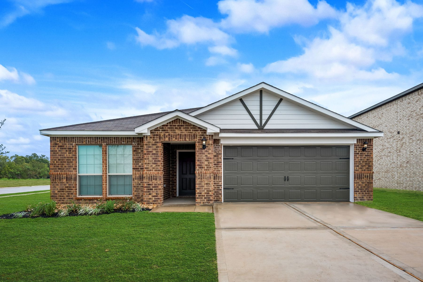 The Topeka by LGI Homes:The Topeka is a gorgeous one-story home at Seagoville Farms.
