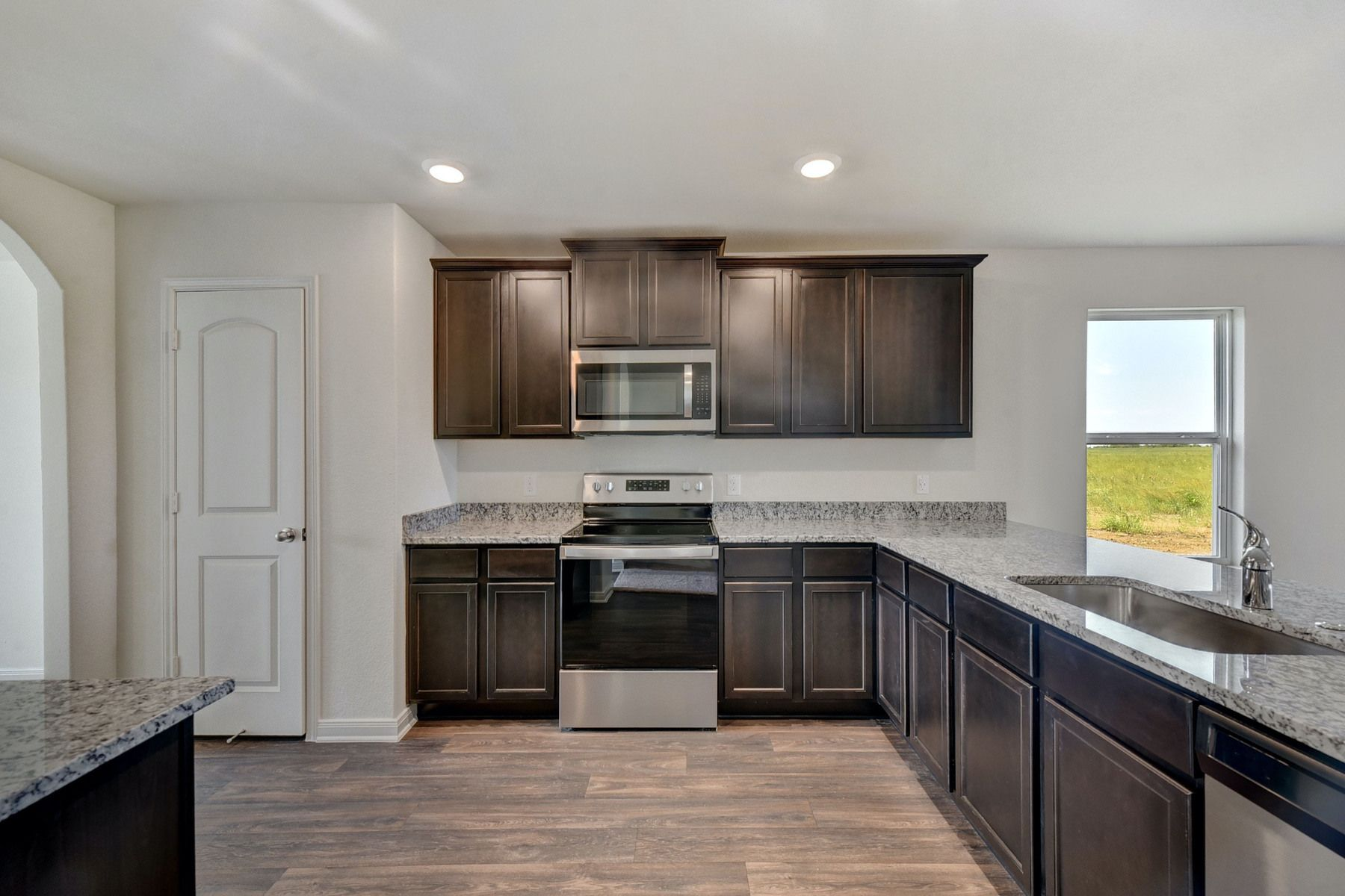 The Frio Plan by LGI Homes:The kitchen comes with a full suite of energy-efficient appliances!