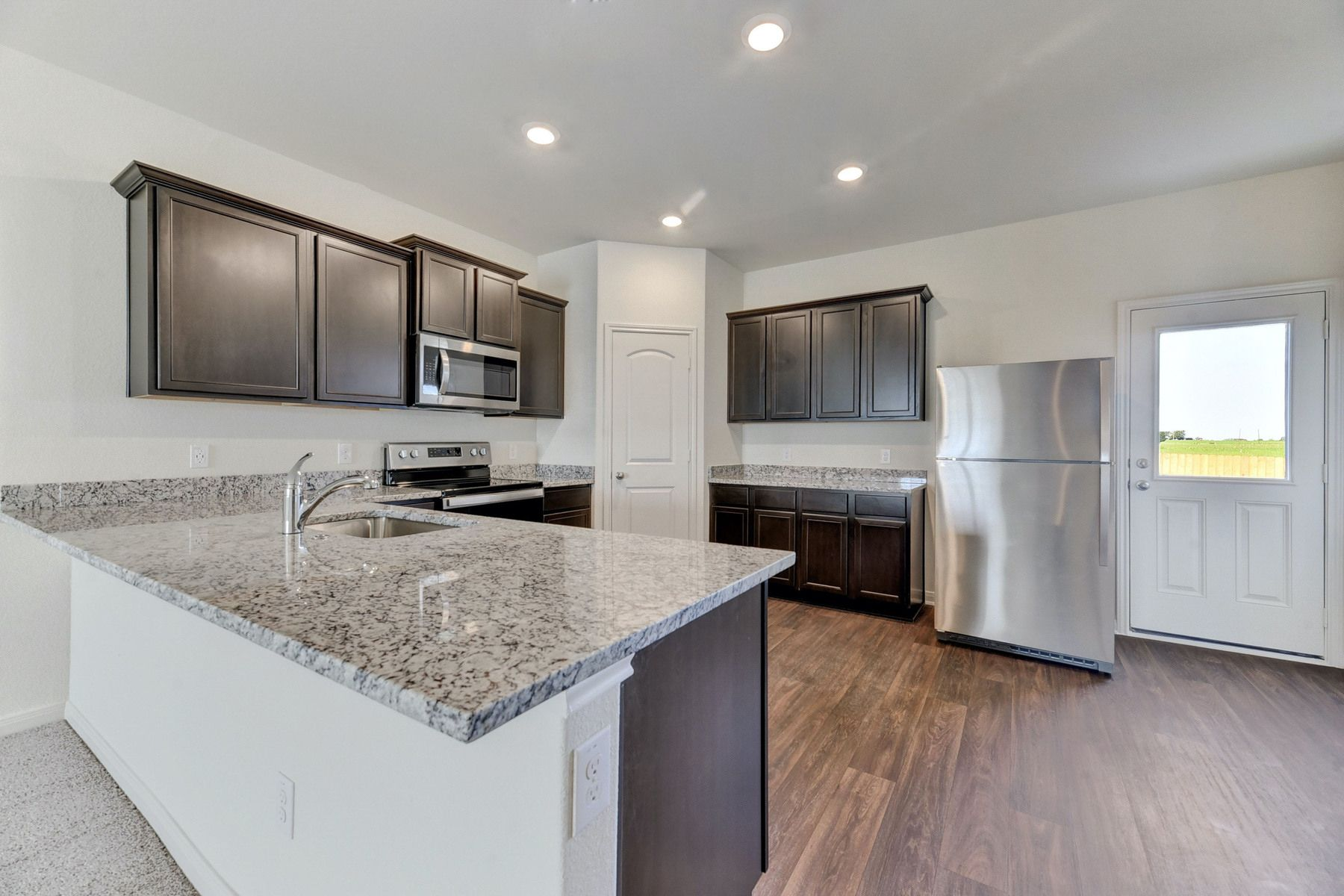 The Travis by LGI Homes:The kitchen comes with a full suite of energy-efficient appliances!