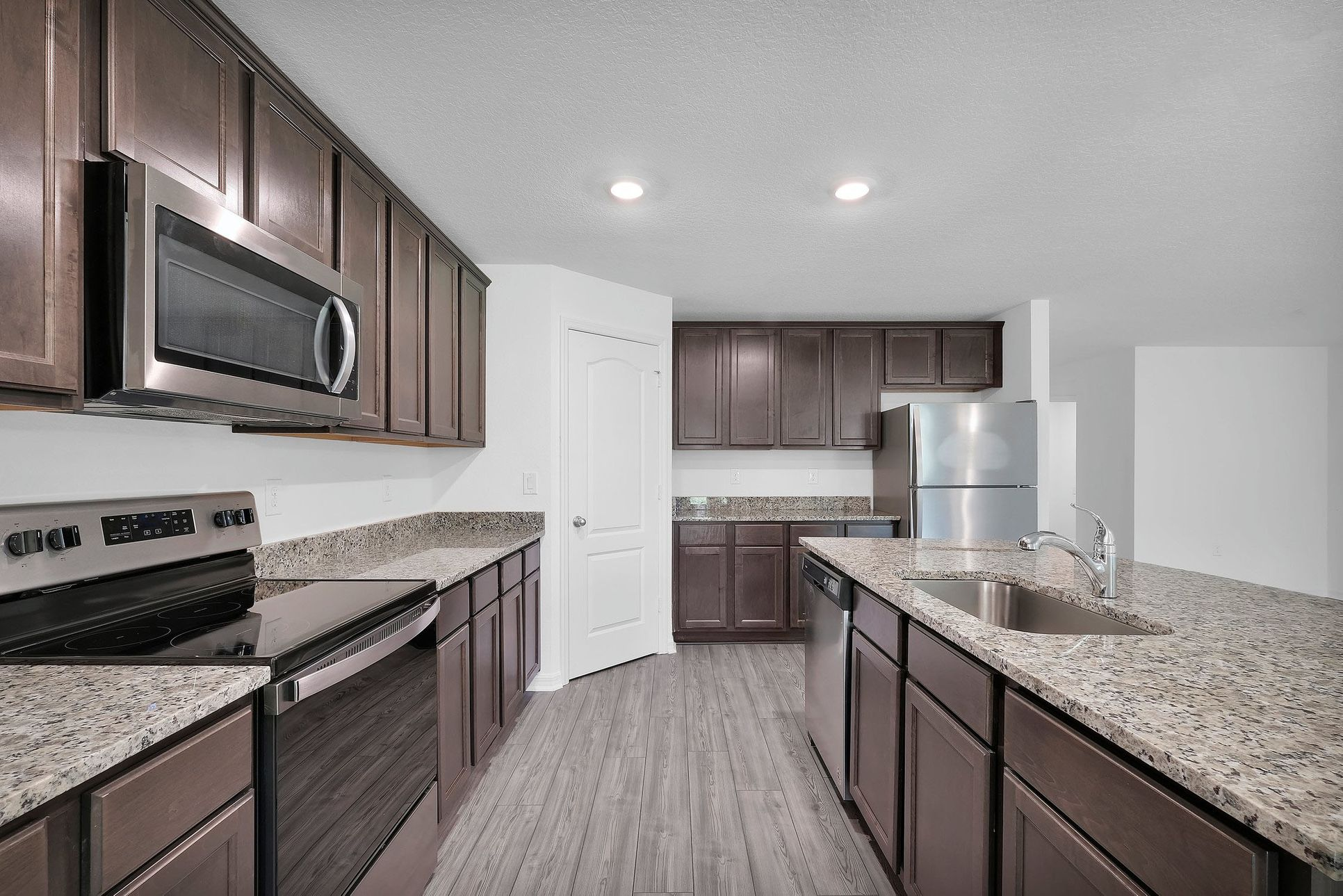 The Capri at Palm Bay:This move-in ready home features gorgeous granite countertops in the kitchen