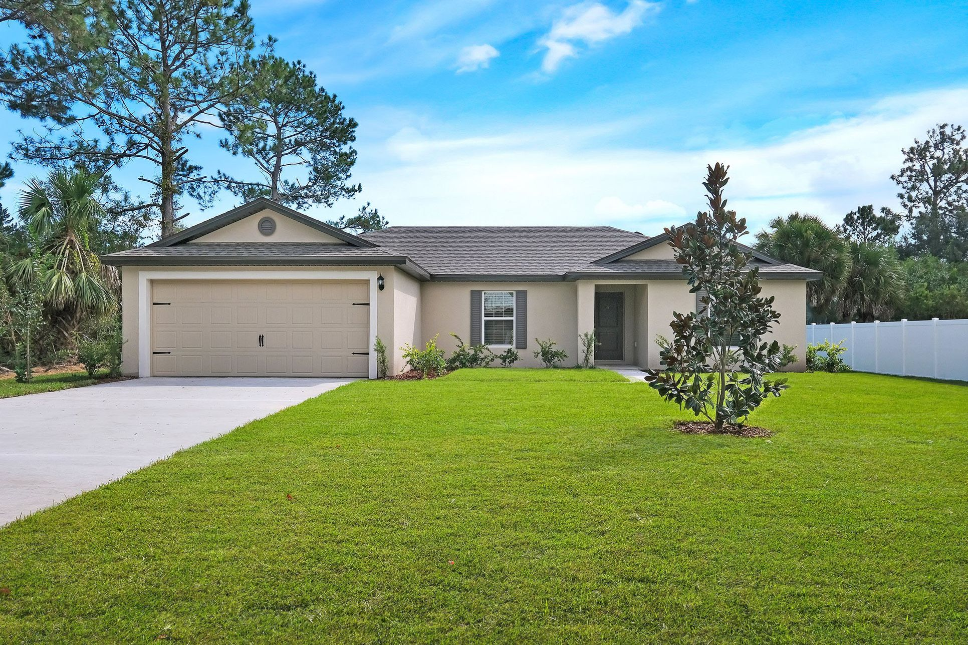 The Caladesi at Palm Coast:Upgraded interiors and features are included with this home!