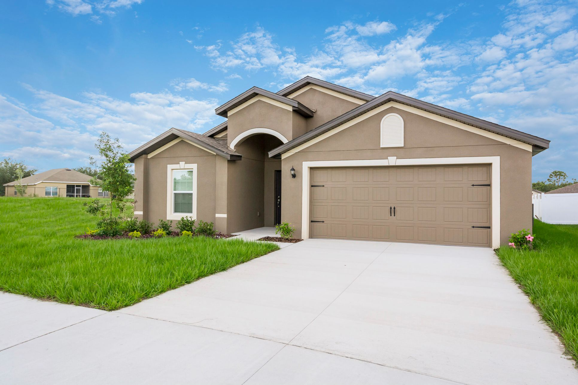 The Estero at The Ridge at Swan Lake:Spacious new home with incredible curb appeal