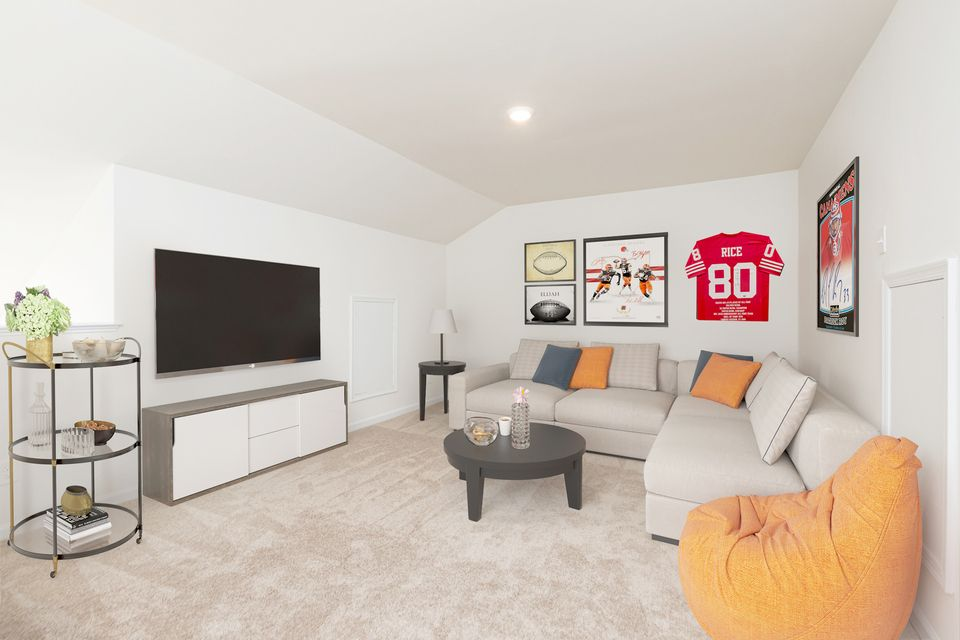 Enjoy the 3rd story game room in the Carol townhome.:LGI Homes at Huntington Pointe