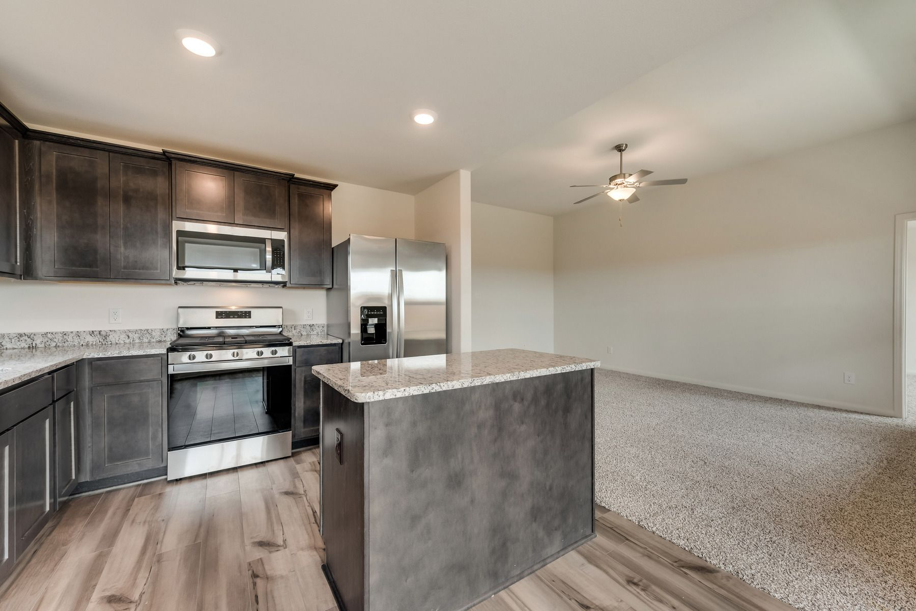 The Blanco by LGI Homes:Enjoy stunning granite countertops and designer wood cabinetry in this kitchen.
