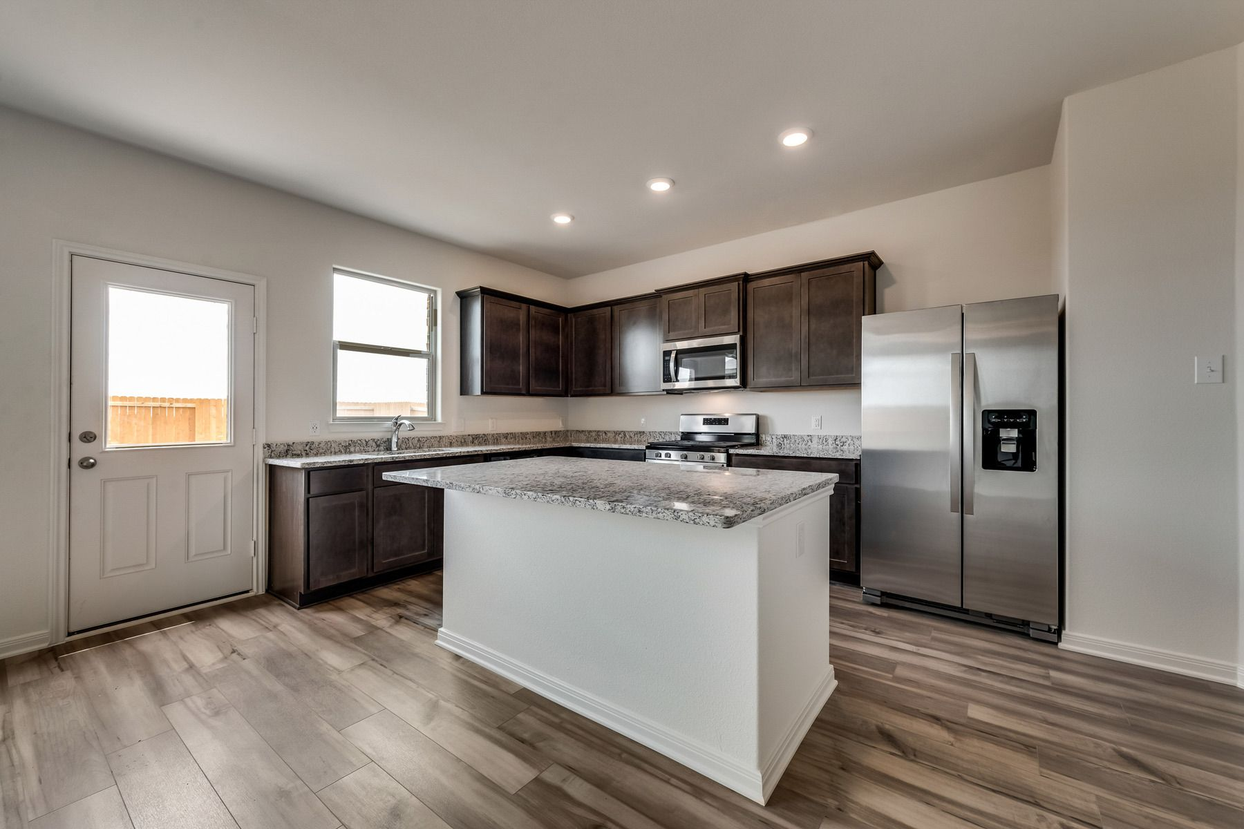 The Jaguar by LGI Homes:Enjoy stunning granite countertops and designer wood cabinetry in this kitchen.