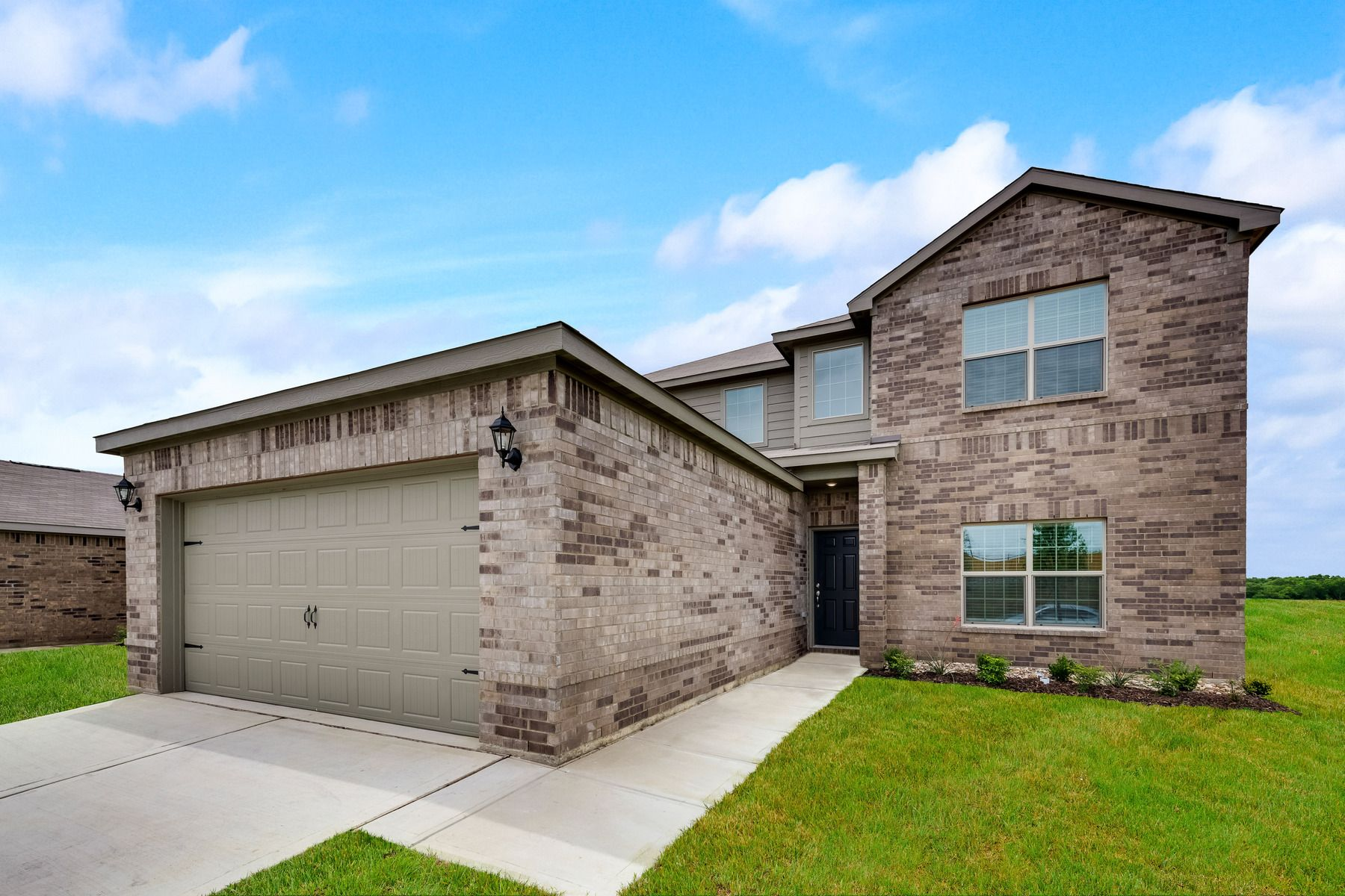 LGI Homes at Shaw Creek Ranch:The gorgeous Oakmont plan has incredible curb appeal.