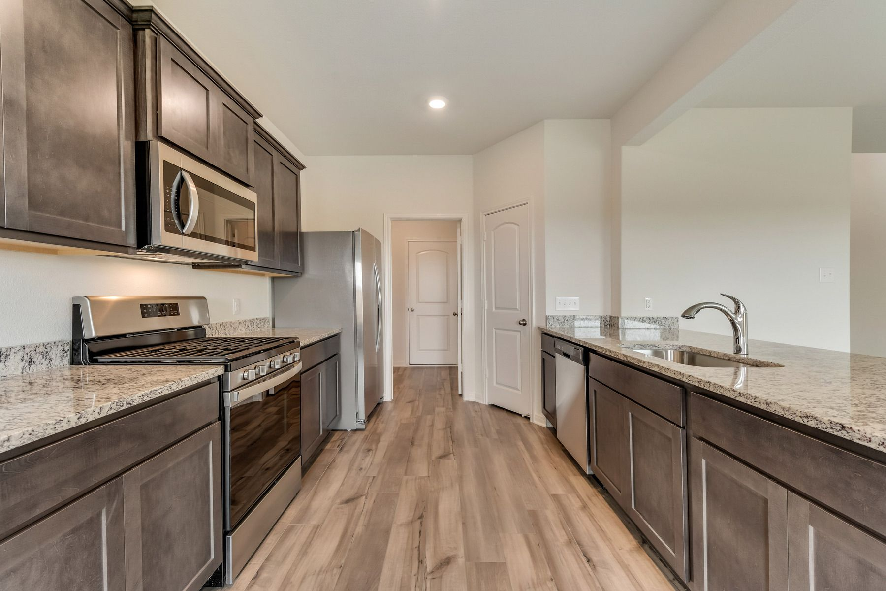 The Cypress by LGI Homes:The kitchen comes with a full suite of energy-efficient appliances!