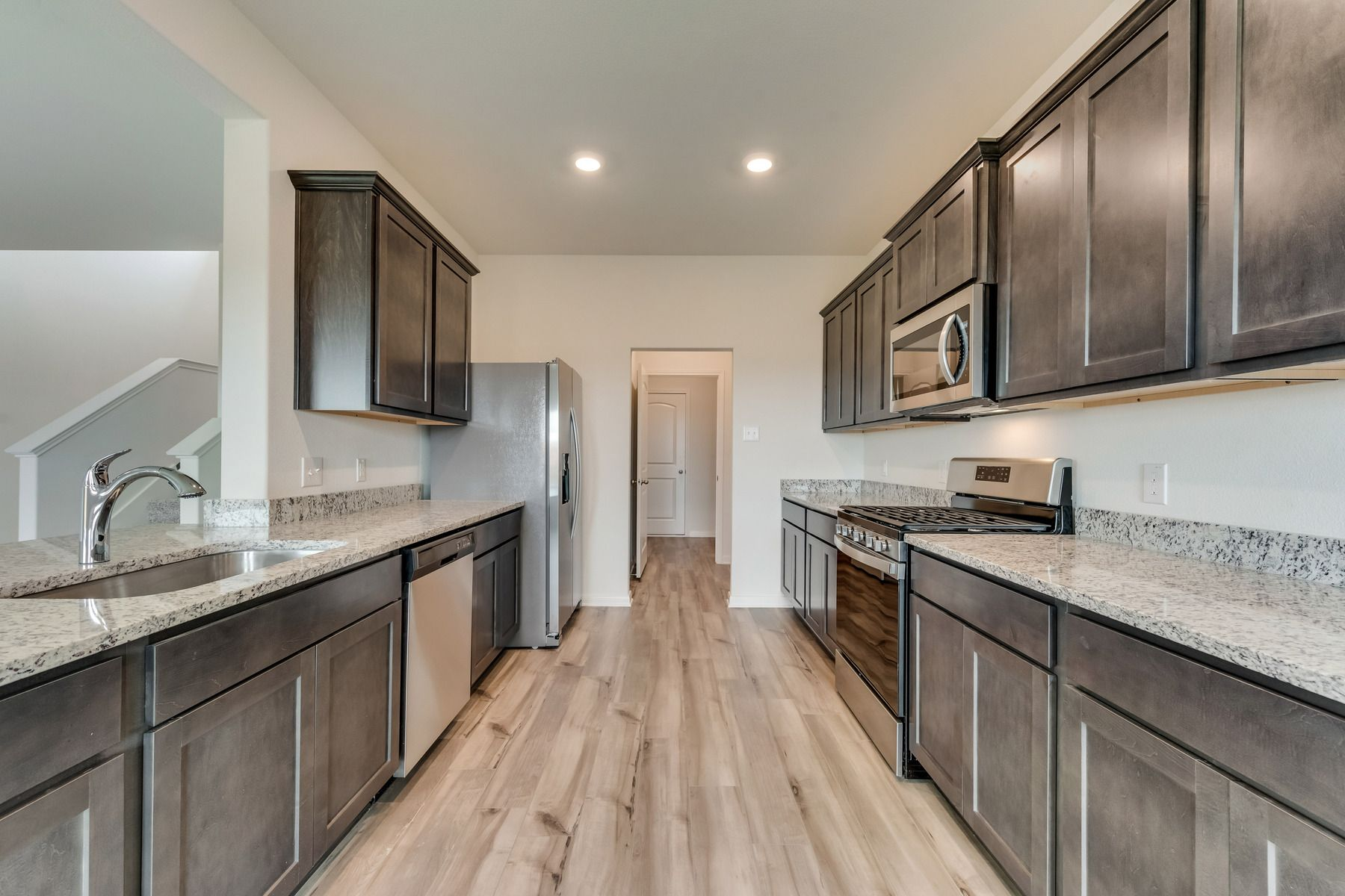 The Oakmont by LGI Homes:The kitchen comes with a full suite of energy-efficient appliances!